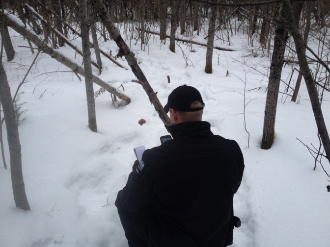 Conservation officer investigating illegal baits.
