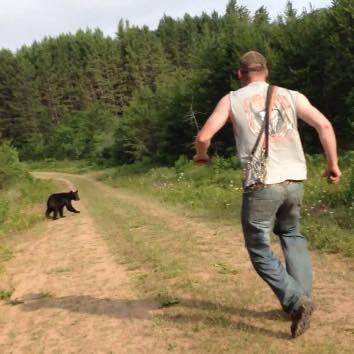 Dertinger chasing a bear cub, Cheq Nic National Forest 2017.